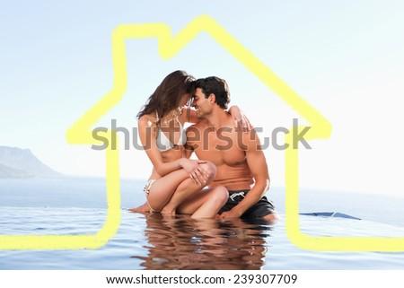 Couple on the pool edge against cloudy sky - stock photo