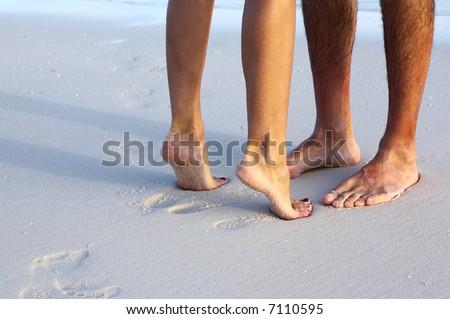 Couple on the sandy beach - stock photo