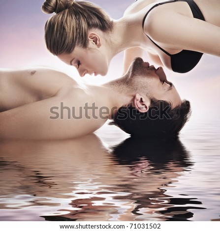 Couple on the surface of water - stock photo