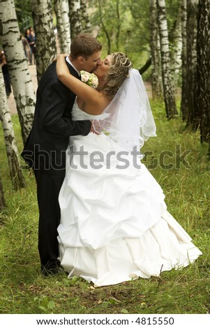 Couple on their wedding day kissing