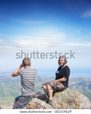 couple on top of a mountain  - stock photo