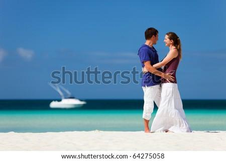 Couple on tropical beach - stock photo
