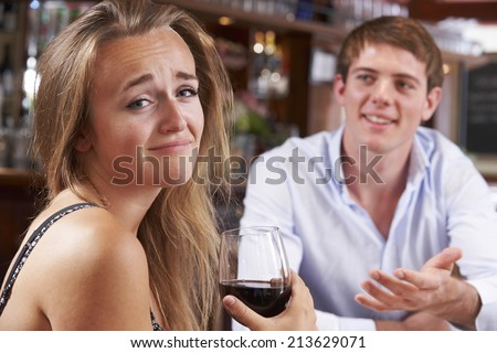 Couple On Unsuccessful Blind Date In Restaurant - stock photo