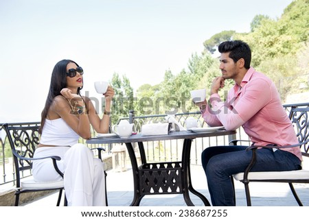 Couple on vacation eating breakfast - stock photo