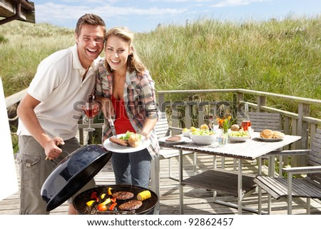 Couple on vacation having barbecue