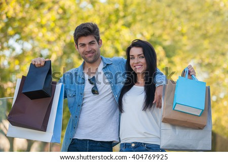COUPLE ON VACATION SHOPPING TRIP - stock photo