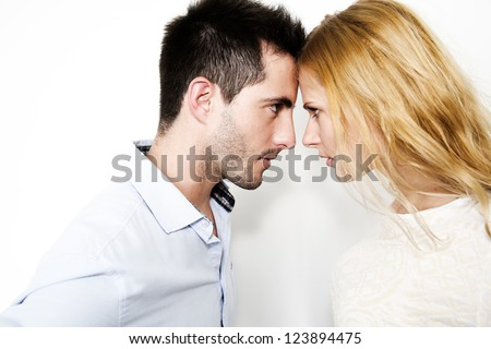 Couple on white background touching foreheads - stock photo