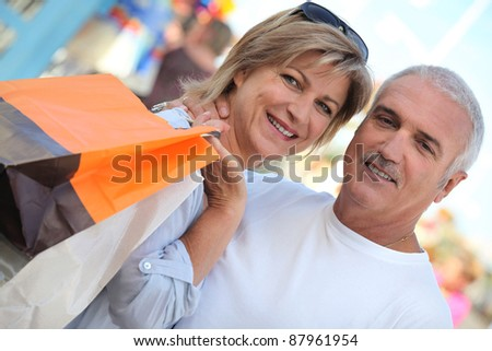 Couple out shopping - stock photo
