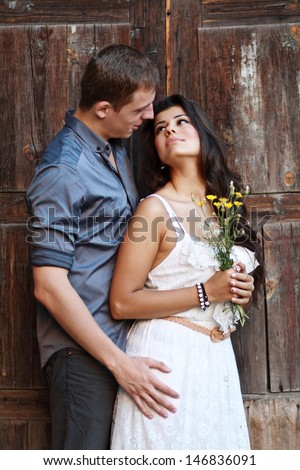 couple outdoor near old door of antique building