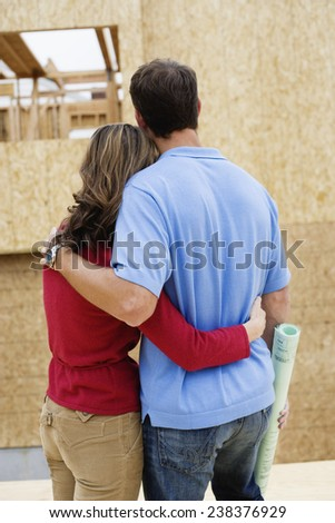 Couple Outside of Home under Construction - stock photo