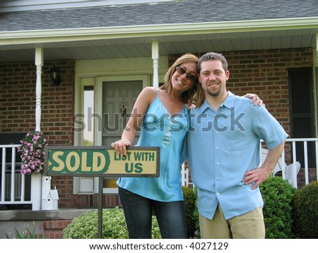 Couple outside of newly purchased house - stock photo