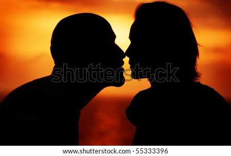 Couple over sunset background - stock photo