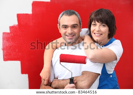 couple painting room in red - stock photo