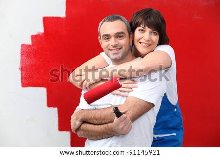 couple painting together - stock photo