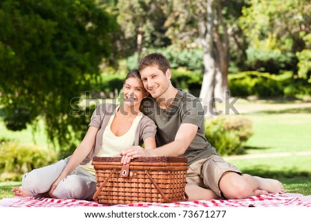 Couple picnicking in the park - stock photo