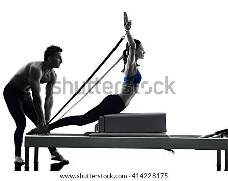 couple pilates reformer exercises fitness isolated - stock photo