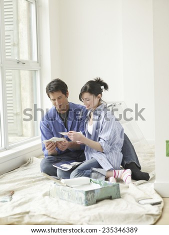Couple Planning for Painting - stock photo