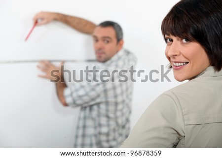 couple planning improvements in their apartment - stock photo