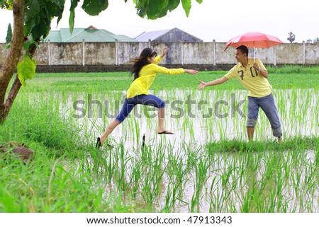 couple playing at rice field - stock photo