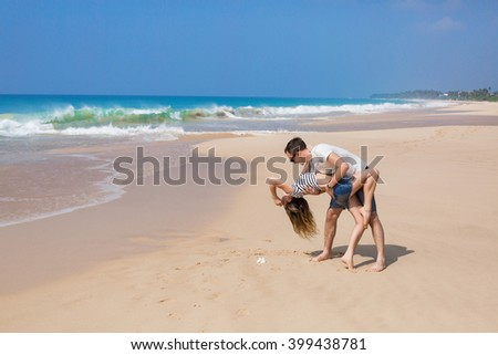 Couple playing at the seashore