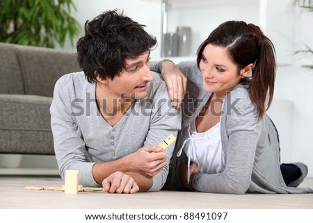Couple playing dominoes - stock photo