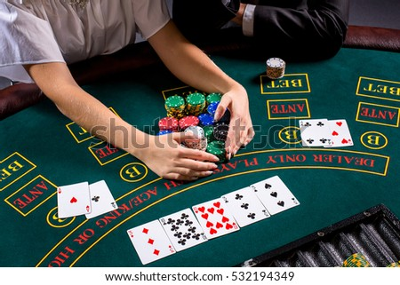 couple playing poker at the table