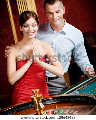 Couple playing roulette wins at the casino - stock photo