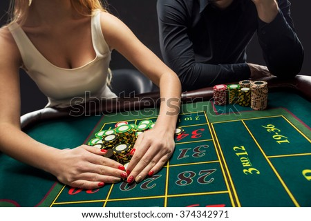 Couple playing roulette wins at the casino. - stock photo