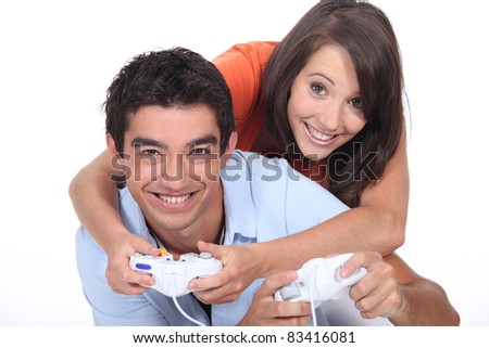 Couple playing video game - stock photo