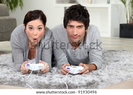 Couple playing video game. - stock photo