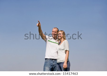 Couple Pointing to Something in the Sky