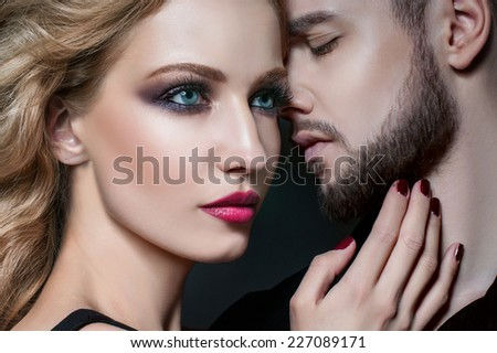 Couple portrait. Beautiful couple in love. Blond woman hugging a man. Valentine couple. Portrait of  beauty blond girl and her handsome boyfriend. Young family. Love. Passion. Lovers. Valentines Day - stock photo