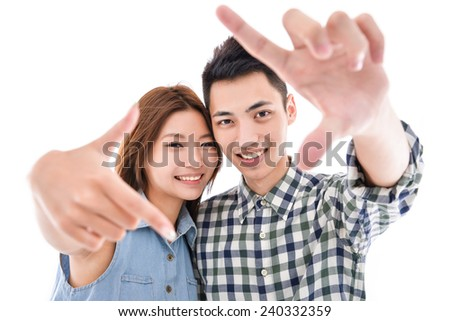 couple portrait forming a frame with their hands - stock photo