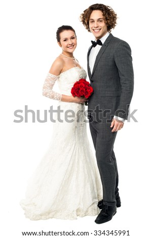 Couple posing together for post wedding shoot - stock photo