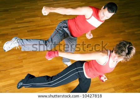 Couple practicing martial art moves