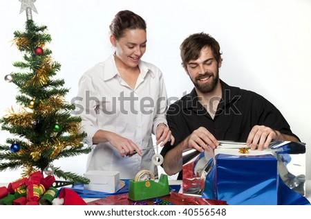 Couple preparing Christmas presents - stock photo