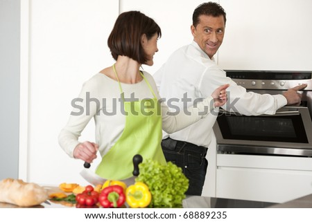 Couple Preparing Meal Together - stock photo