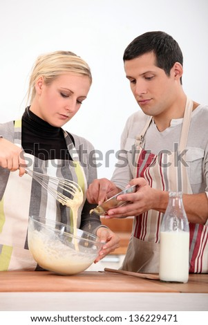 Couple preparing recipe - stock photo