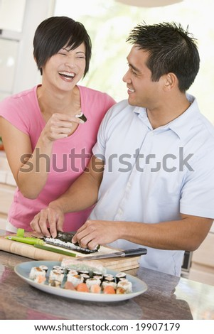 Couple Preparing Sushi Together - stock photo