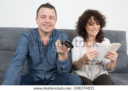Couple Reading book at Home - stock photo