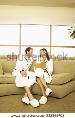 Couple Reading Book at Spa - stock photo