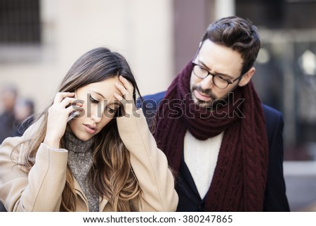Couple receiving bad news over the phone - stock photo