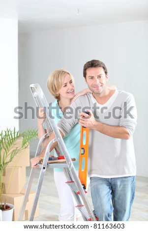 Couple redecorating home - stock photo