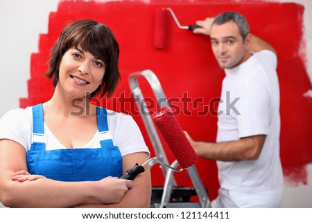 Couple redecorating their house - stock photo