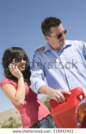 Couple refueling car - stock photo