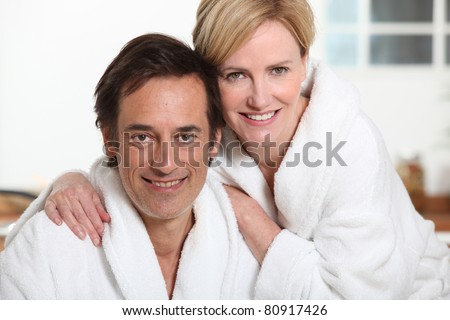 Couple relaxing at home in dressing gowns