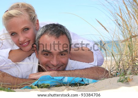 Couple relaxing at the seaside - stock photo