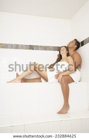 Couple Relaxing in a Steam Room - stock photo