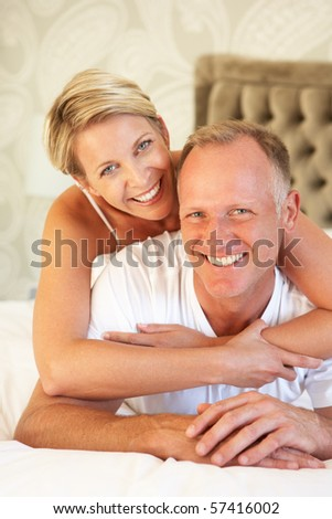 Couple Relaxing In Bedroom - stock photo