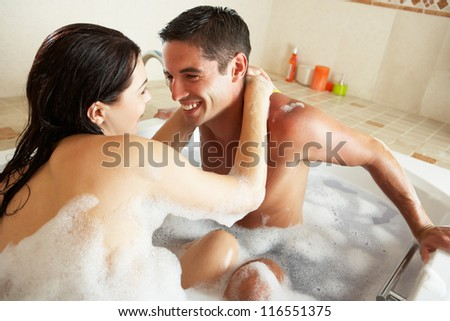 Couple Relaxing In Bubble Filled Bath - stock photo